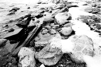 Winter Lakeshore, Rocks, Sand, Ice, and Snow at Sturgeon Point on Lake Erie