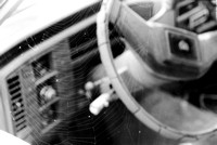A Spider Web in a Window of an Old Cadillac on Fomapan 400 Black and White Film with Nikon FE2