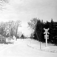 Railroad Crossing, 3 Tracks, Back Roads in Winter in Orchard Park, New York.