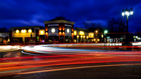 Busy Staub Square & Juicy Burger Bar at dusk, traffic at the main circle, Hamburg, NY, Buffalo Southtowns