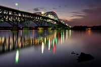 Illuminated South Grand Island Bridge at Dusk connecting Tonawanda, NY and Grand Island, NY. Bridge and illumination reflected in the Niagara River.
