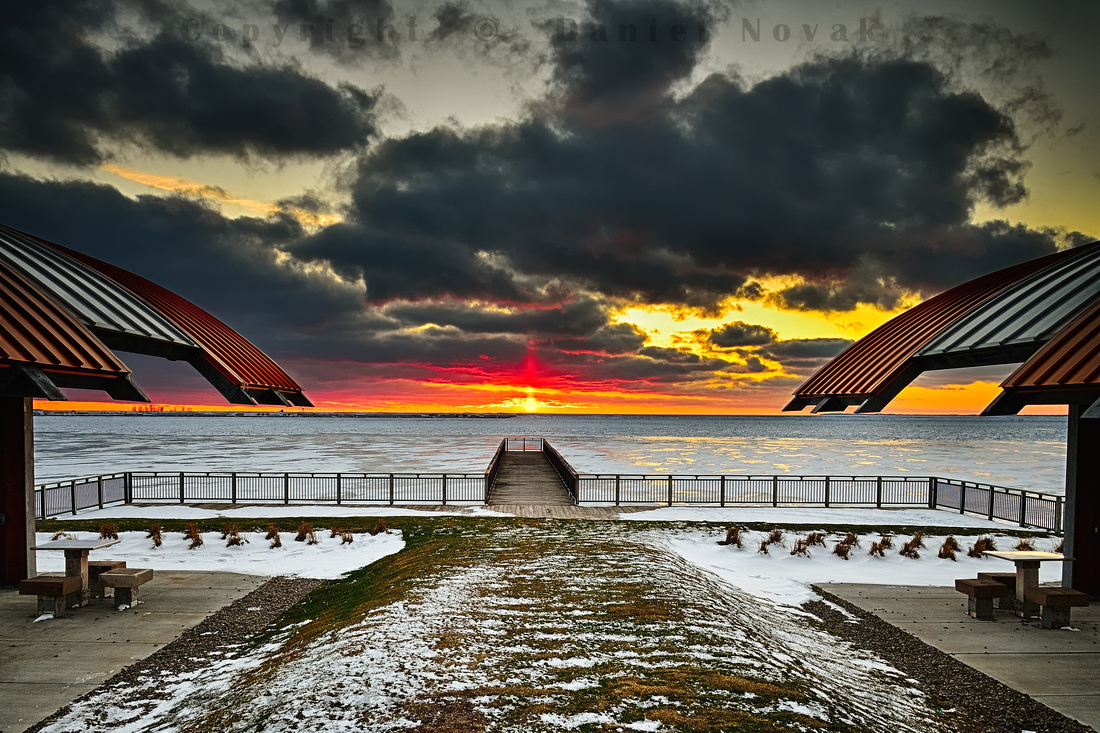 Traveling sunset observed at Gallagher Pier on February 6, Outer Harbor, Buffalo, New York (NY).