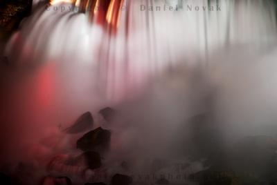 Different take on the grand waterfall - a close up on illuminated American Falls, Niagara Falls.