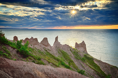 The spires of Chimney Bluffs on south shore of Lake Ontario against the setting sun.