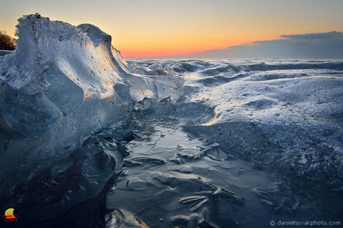 In an Ice Crack, Frozen Lake Erie, Western New York Winter Sunset