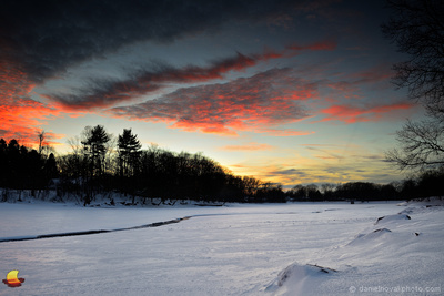 Sunset Fire over Frozen Green Lake, Yates Park, Orchard Park, New York (NY).