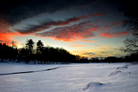 Sunset Fire over Frozen Green Lake, Winter in Yates Park, Orchard Park, New York (NY).