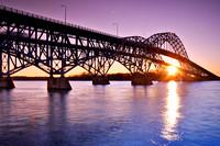 Sunrise over the South Grand Island Bridge and Niagara River looking from Grand Island towards Tonawanda, NY and Buffalo.