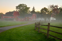 A fence-lined path to misty red barns, Knox Farm, East Aurora, NY
